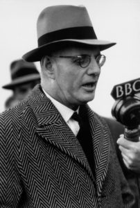 John Curtin speaking into microphone